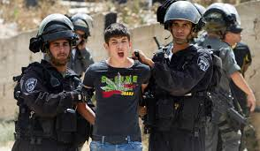 16 year old West Bank Palestinian youth arrested by Israeli military for peacefully protesting the Israeli attack on Gaza last fall.