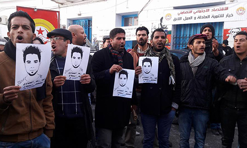 Kasserine, Tunisia youth protesting the suicide by electrocution of Ridya Yahyaoui in from of the offices of the local trade union federation (UGTT)