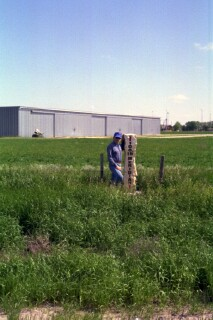 Me, in 2003, standing by the marker of the 100th Meridian just west of Cozad, Nebraska