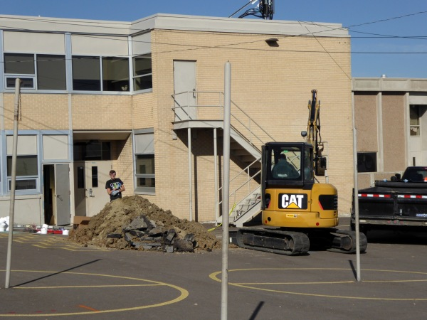 Trying to cut into the sewer line at Adventure Elementary School in Mapleton (just north of Denver) to locate the source of the stench