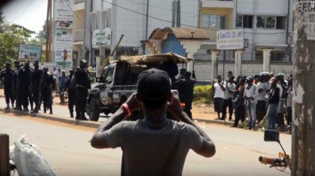 Cameroonian youth protesters being arrested and many look on